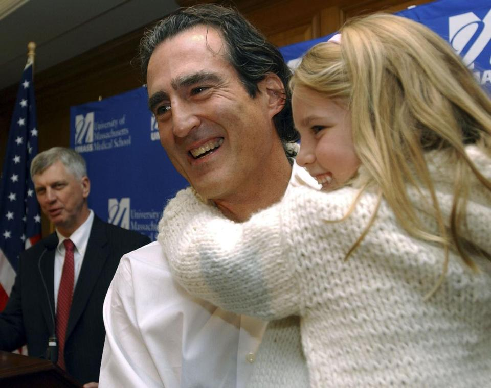 Craig Mello, holding his daughter after a press conference in October 2006 announcing that he shared the Nobel Prize in medicine,  said the honor didn't alter his life much.