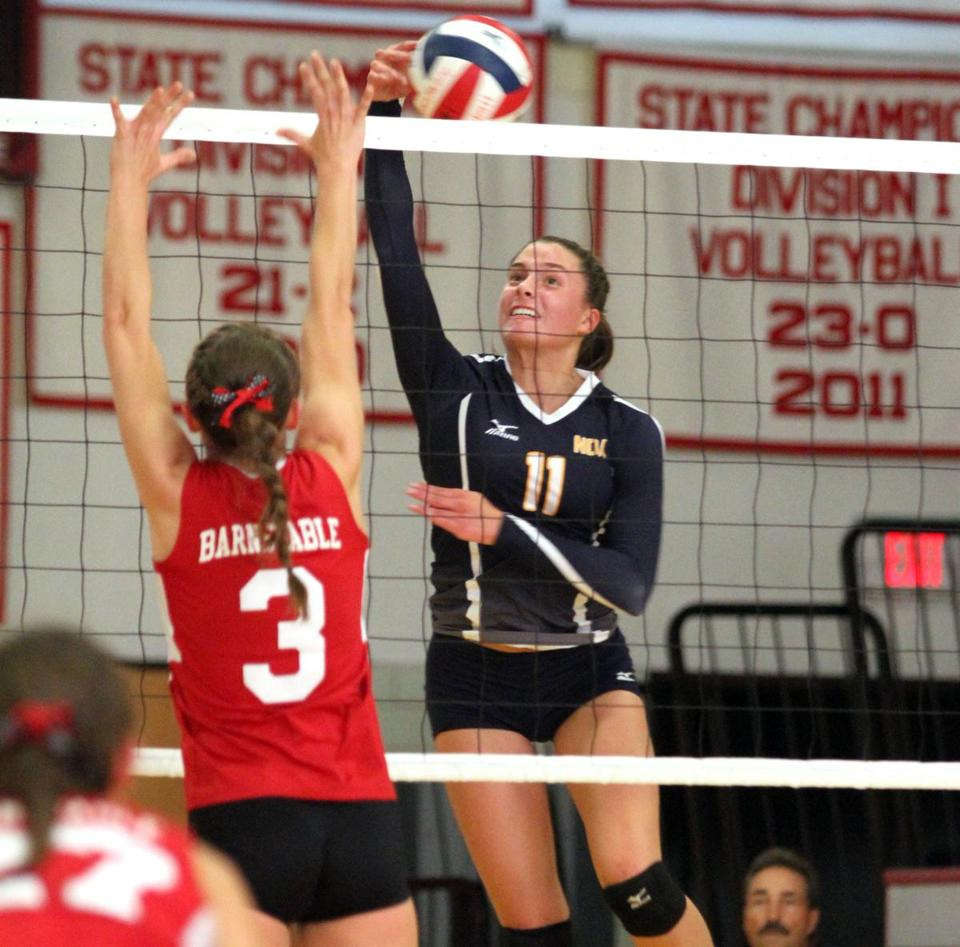 Notre Dame's Avery Spaziani goes up for a spike over Barnstable's Olivia Brodt.
