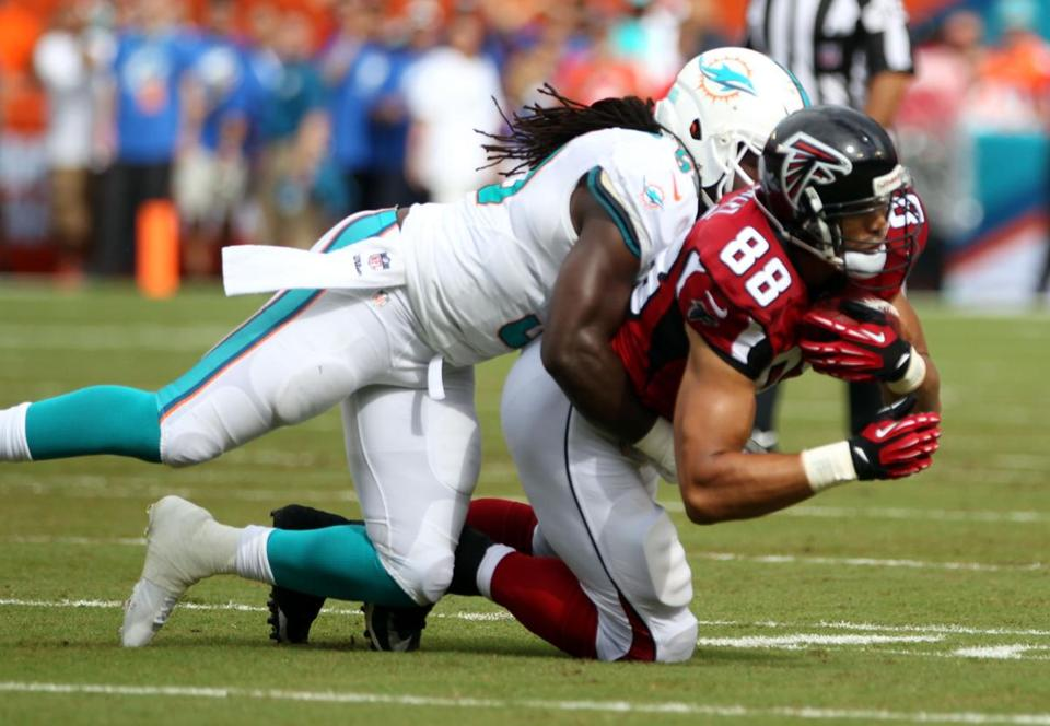 Veteran Falcons tight end Tony Gonzalez (right), the NFL's career receptions leader at the position, still earns a good chunk of the defensive focus.