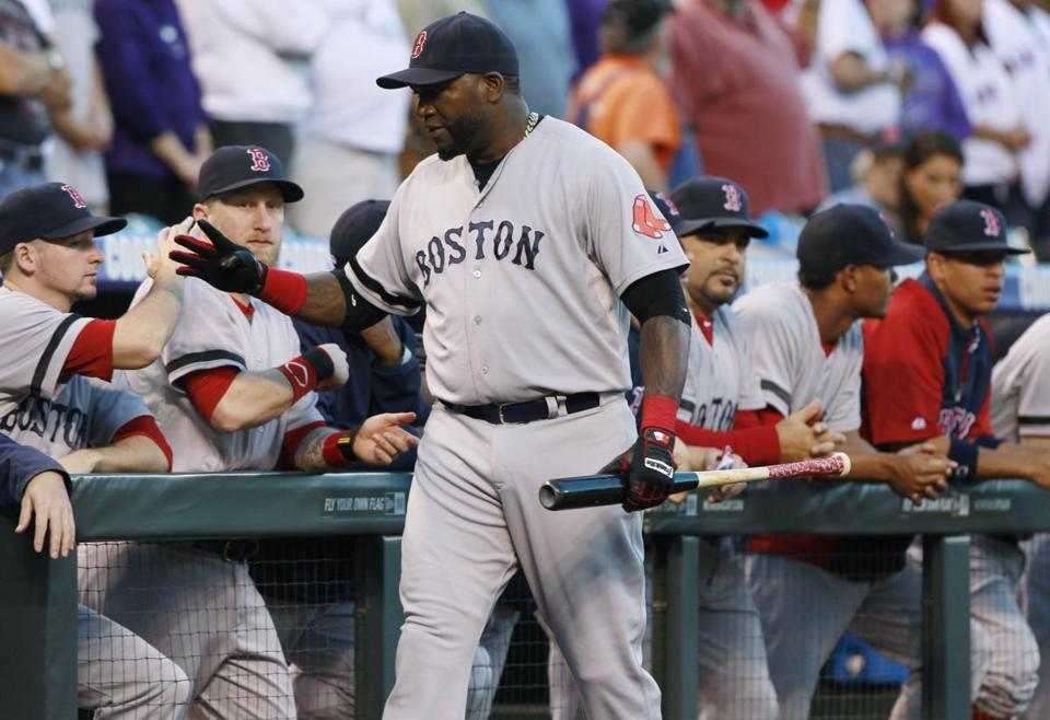 David Ortiz greeted teammates Wednesday before an at-bat. Ortiz was playing first base as Mike Napoli sat for the fourth consecutive game.