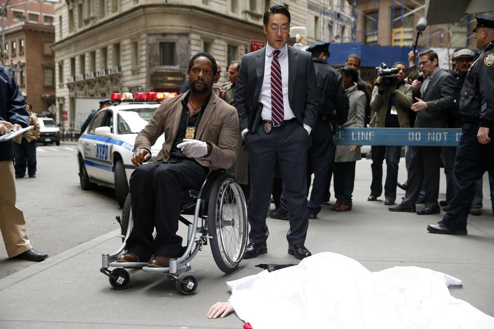Blair Underwood as Detective Robert Ironside (in wheelchair, with Kenneth Choi) in NBC's reboot of the '60s series that starred Raymond Burr.