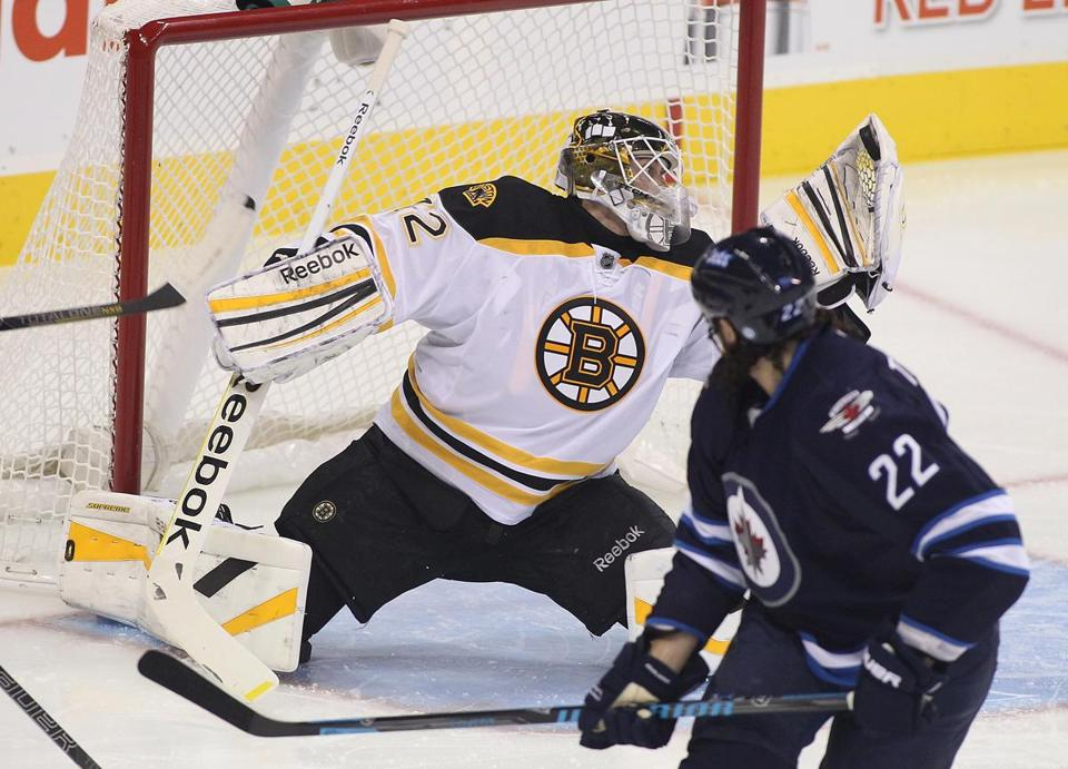Niklas Svedberg made a nice save on Chris Thorburn of the Jets during Thursday's preseason game in Winnipeg.