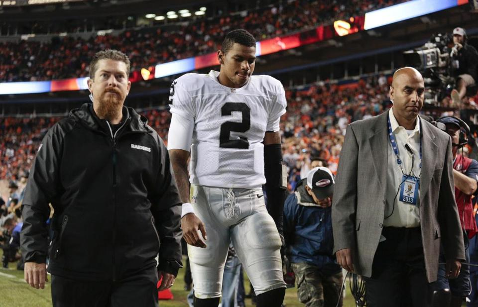Raiders quarterback Terrelle Pryor left the field late in the fourth quarter of Monday's game against the Broncos.