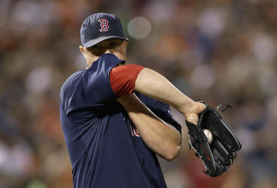 Red Sox starting pitcher Jon Lester wiped sweat from his face between pitches during the second inning.