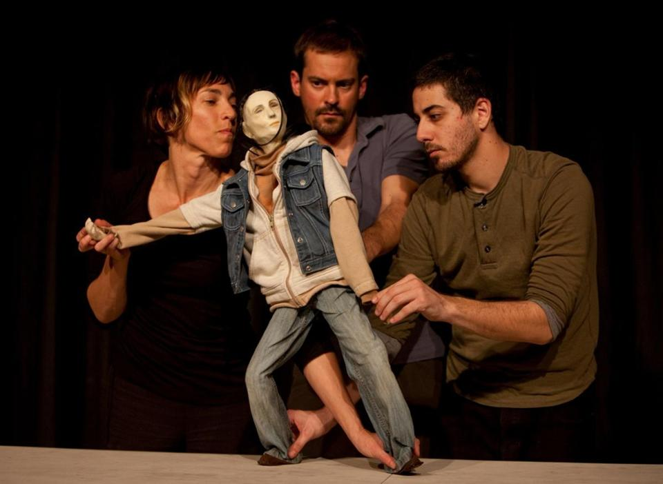 "From left: Puppeteers Rachael Lincoln, Darius Mannino, and Zach Tolchinsky with a character from ""Who's Hungry."""
