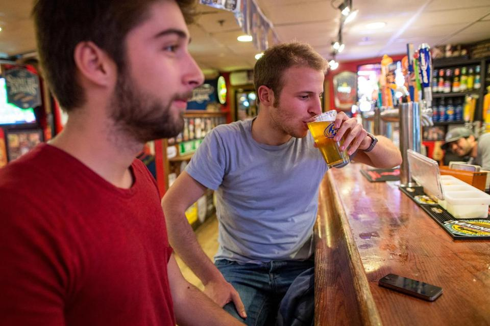 Giovanni Carrara (right) had Angry Orchard Hard Cider at Conor Larkin's Grill & Tap in Boston. His friend Konstantinos Berios was drinking beer. The bar's general manager says Angry Orchard quickly became a hit drink at the establishment.
