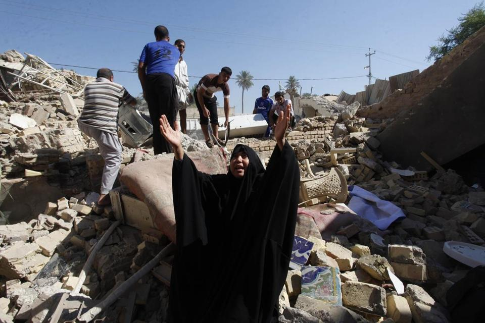 Iraqis combed through the rubble Monday after a suicide bomb attack on a Shi'ite mosque in Mussayab the day before.
