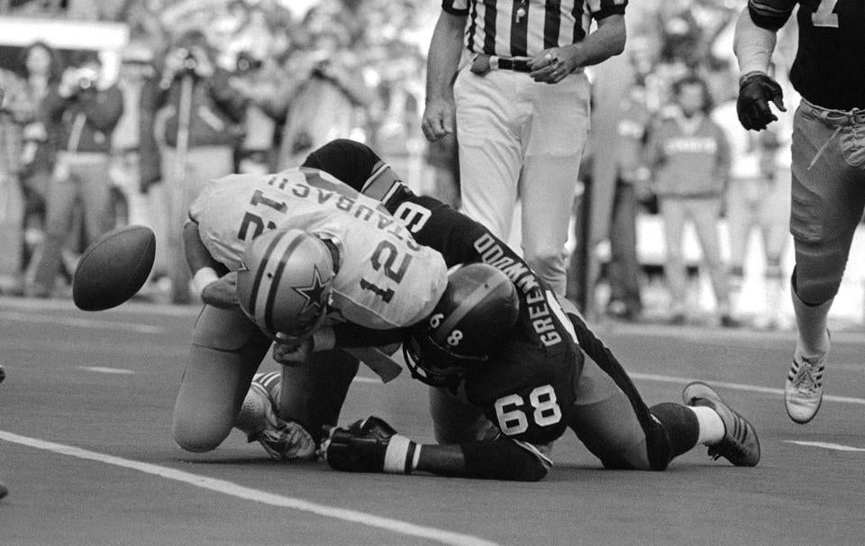 The ball came loose as Dallas quarterback Roger Staubach was tackled by L.C. Greenwood during a regular season game in Pittsburgh.