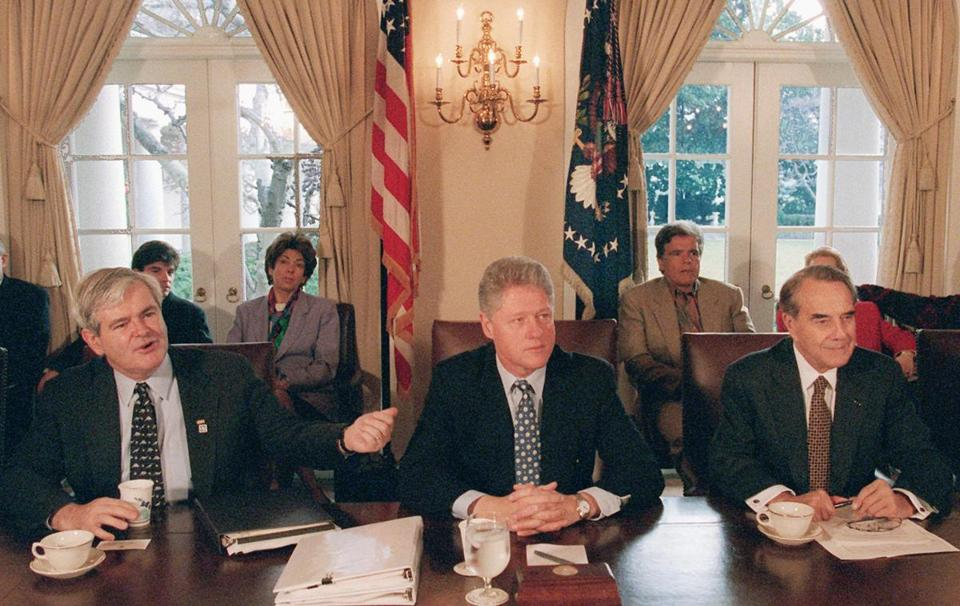 President Bill Clinton met with House Speaker Newt Gingrich (left) and Senate Majority Leader Bob Dole to grapple with competing balanced budget plans in 1995.