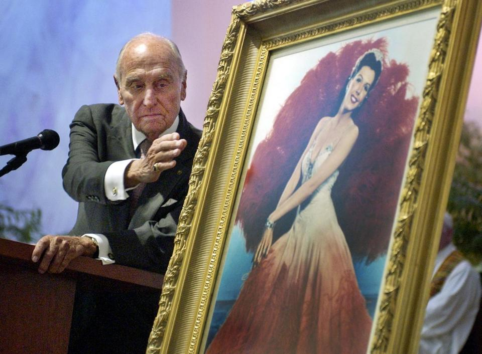 A.C. Lyles reached toward a portrait of Ann Miller during a funeral for the dancer and actress in 2004.