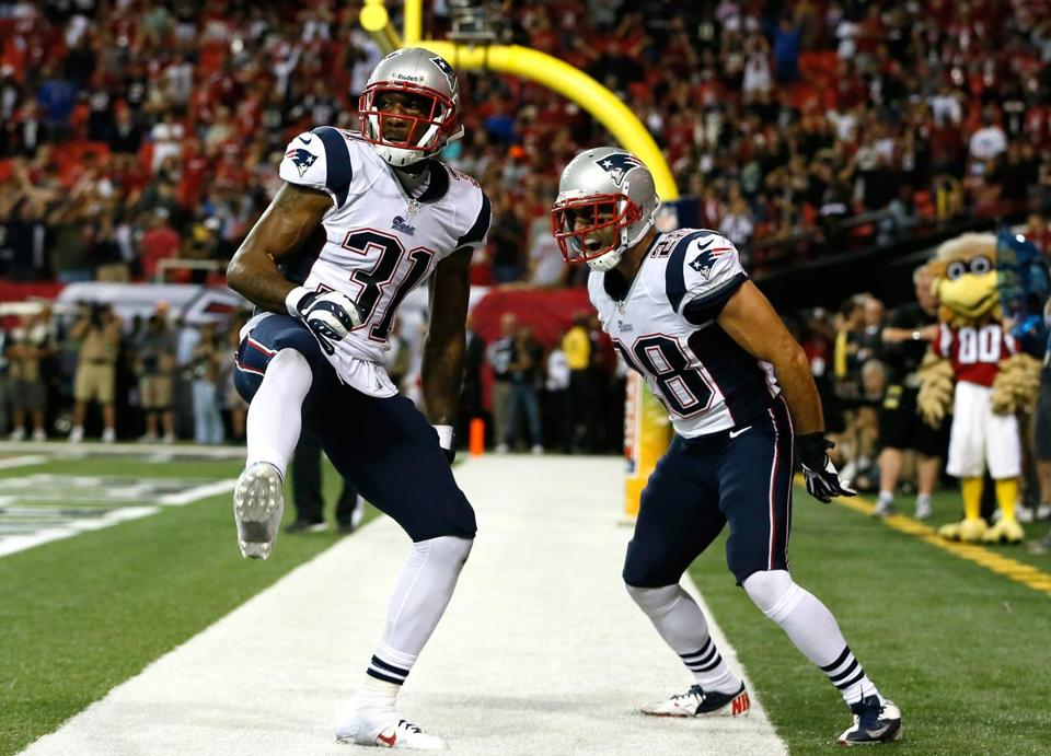Aqib Talib and Steve Gregory were pumped after Talib up a touchdown reception intended for the Falcons' Roddy White.