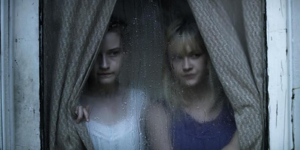 "Julia Garner (left) plays Rose and Ambyr Childers is her sister, Iris, in ""We Are What We Are."""