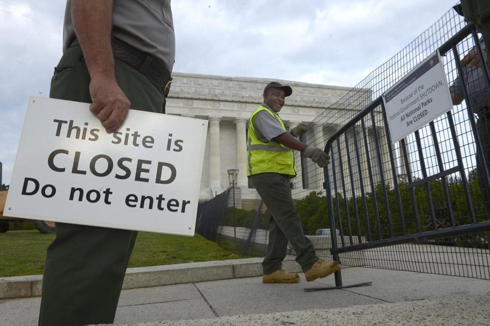 US Park Service personnel erected barriers and hung signs as they closed the Lincoln Memorial on Tuesday.