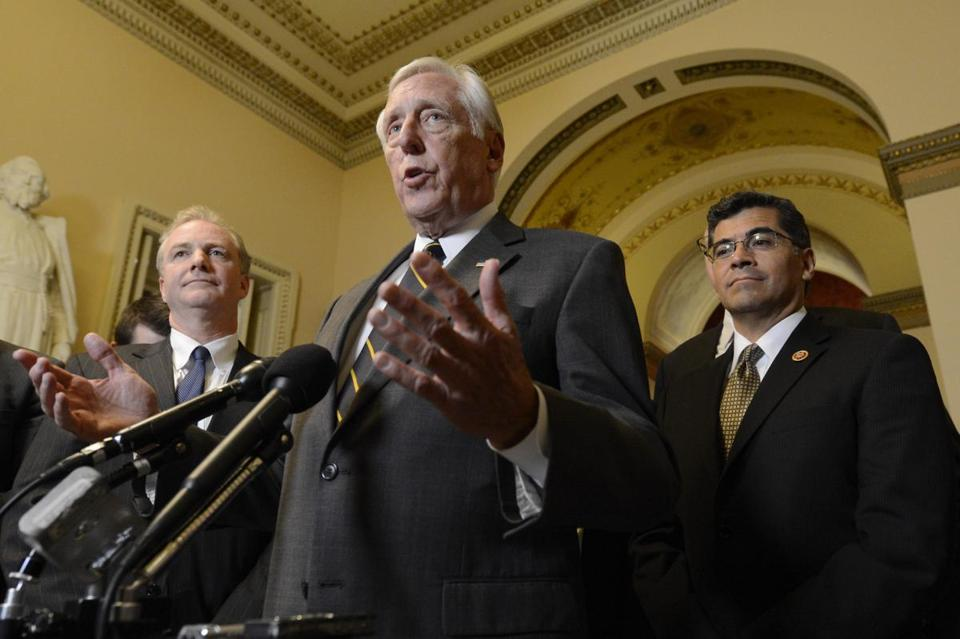 Democratic Representative from Maryland Steny Hoyer spoke to the media beside Democratic Representative from California Xavier Becerra (R) and Democratic Representative from Maryland Chris Van Hollen, shortly before the midnight deadline for a government shutdown.