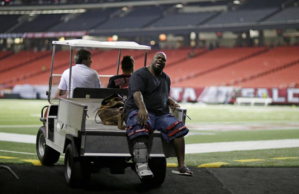 Vince Wilfork, who was hurt on the opening series Sunday, was carted off the field afterward with a right Achilles' tear.