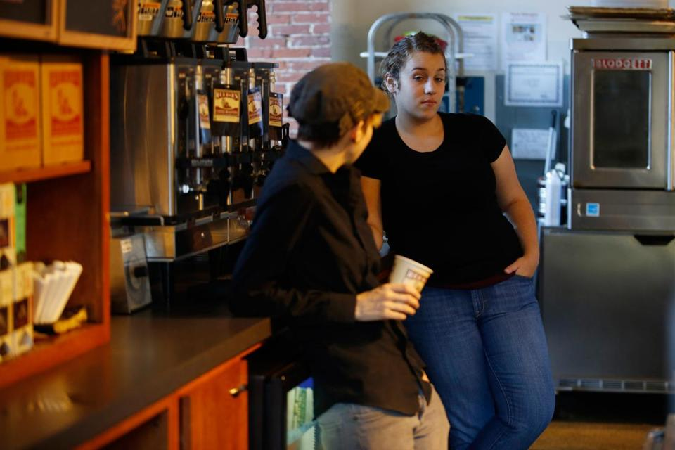 "Sarah Slowick and Brittnay Roberts waited at Red Barn Coffee Roasters in Faneuil Hall. A National Park visitor center was unstaffed, so traffic was slow. ""It's like having a cafe at the aquarium with the tanks shut down,"" the shop owner said."