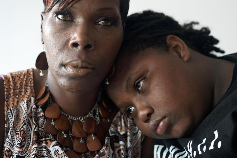 """I used to say, 'I'm gonna kill this guy, whoever he is. He's gonna pay.' But I know it wouldn't make me feel better,"" said Amani, (shown with his mother, Audrey) who lost his brother to a shooting seven years ago."
