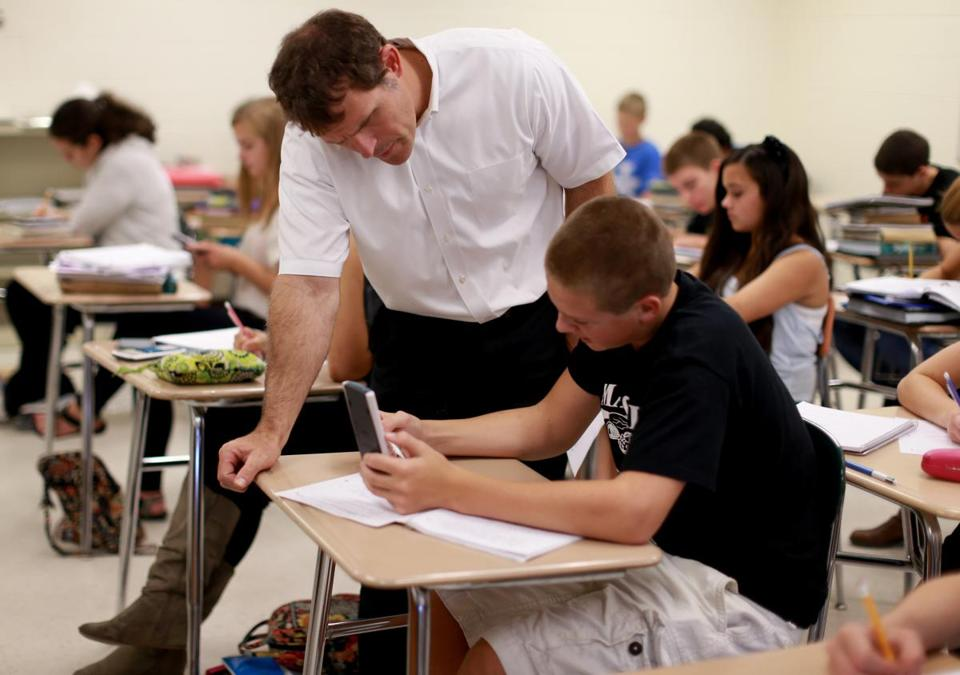 Mansfield High math teacher David Mitchell works with freshman Josh London in an algebra 1 class. The school leads in math growth.