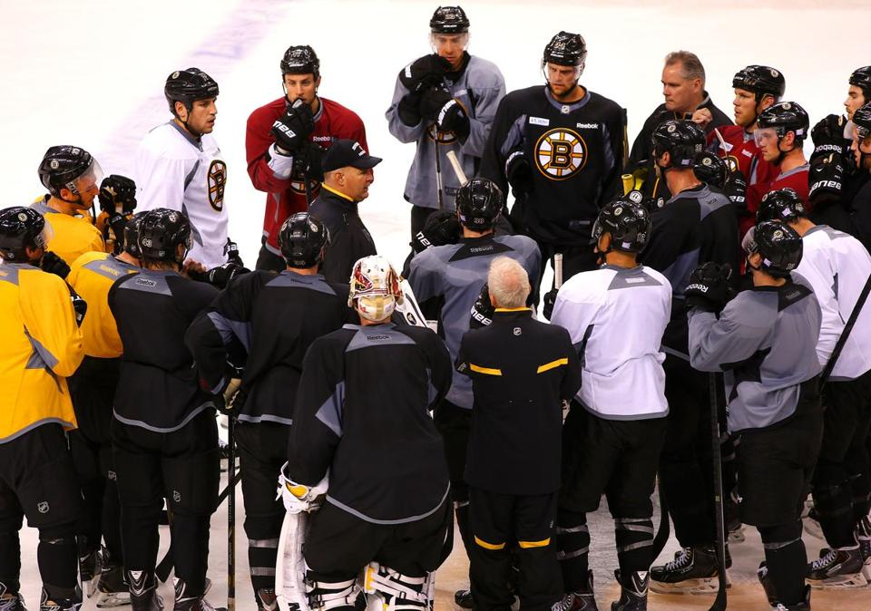 Boston-10/02/13 - The Boston Bruins practiced at the TD Garden in preparation for Thursday's season opener. Coach Claude Julien speaks to the players at the end of practice. Boston Globe staff Photo by John Tlumacki(sports)