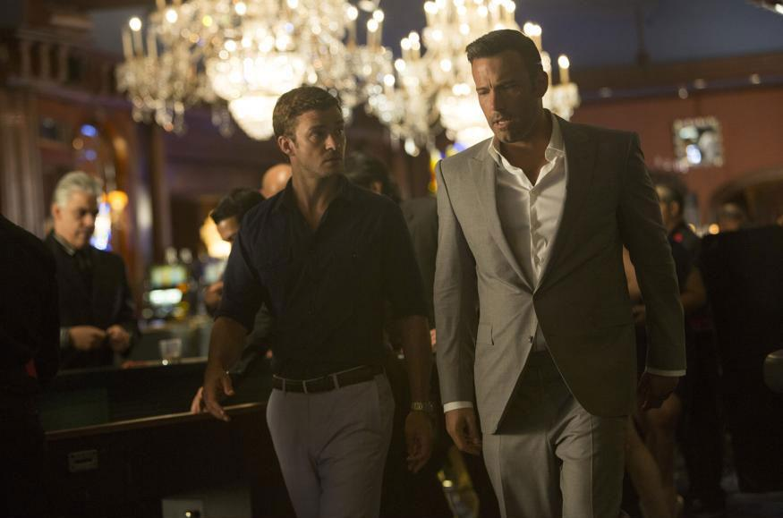 "Ben Affleck shows Justin Timberlake the ropes of his gambling operation in a scene from ""Runner Runner."""