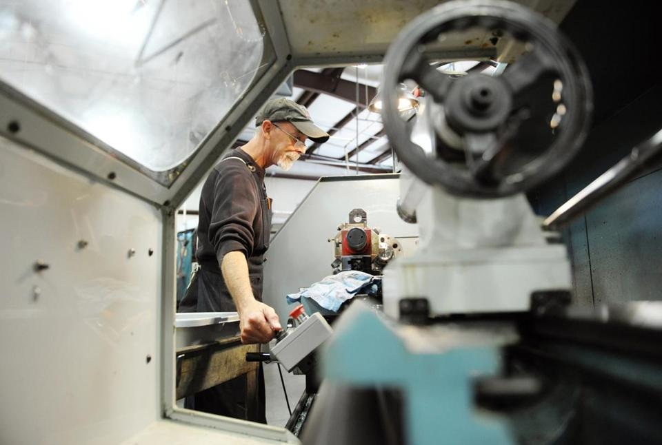 Dan Hurley operated a CNC lathe at Phillips Precision Inc., a Boylston company that makes plastic and metal products for various industries, last week.
