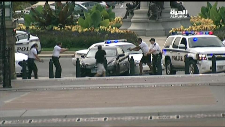 US Capitol Police surrounded a black sedan with guns drawn at the corner of Pennsylvania Avenue and First Street NW in Washington on Thursday.