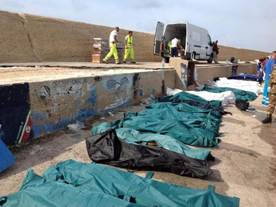 Bodies of migrants were lined up in the port of Lampedusa, Sicily, on Thursday. About 250 people are still missing.