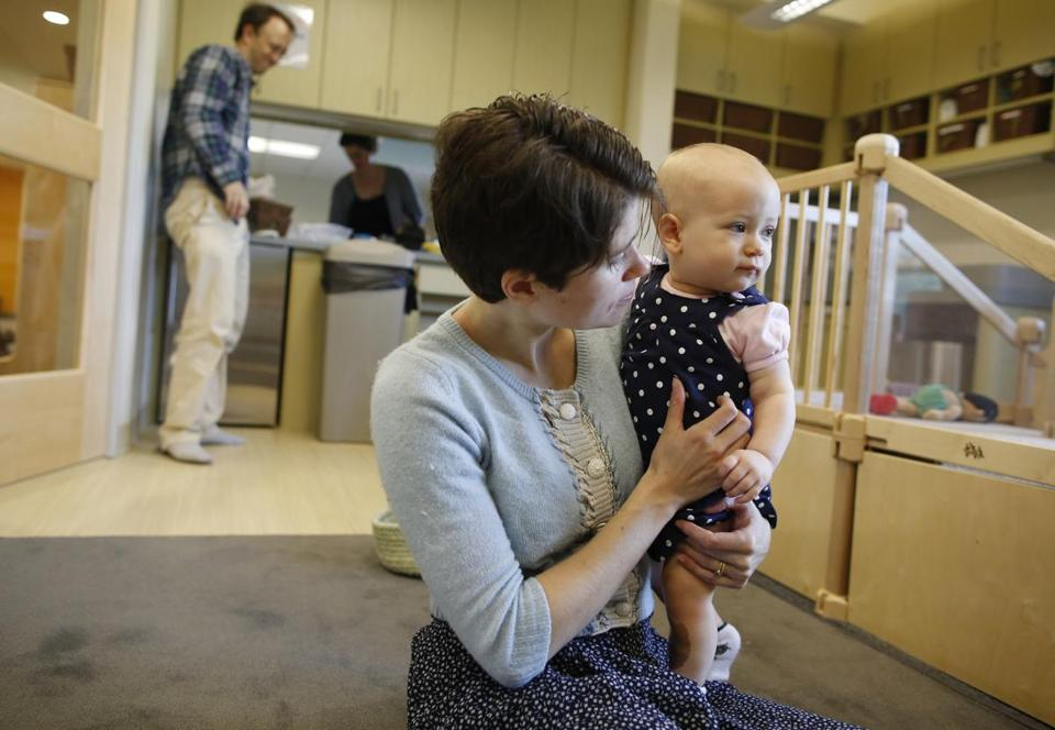 "MIT graduate students Chris and Elizabeth Follett with 10-month-old Marie at the new day-care center. Chris Follett called day care a ""great experience."""
