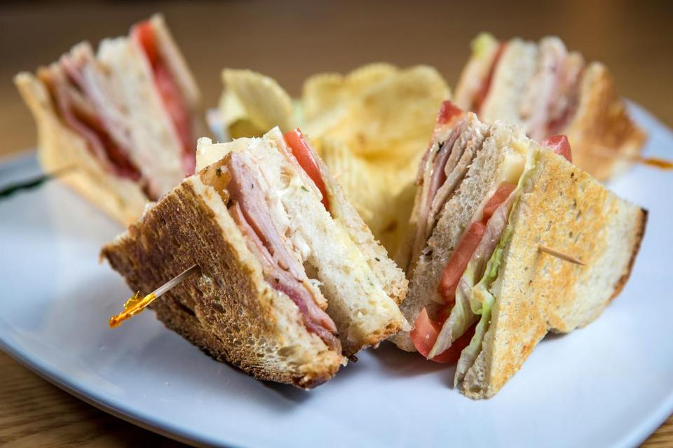 The RL Club turkey sandwich, served with potato chips.