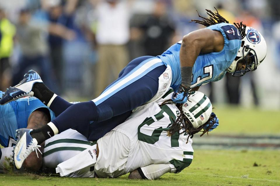 Titans safety Michael Griffin, shown tackling Alex Green of the Jets on Sunday, was fined $21,000 for a hit on Jets receiver Stephen Hill.