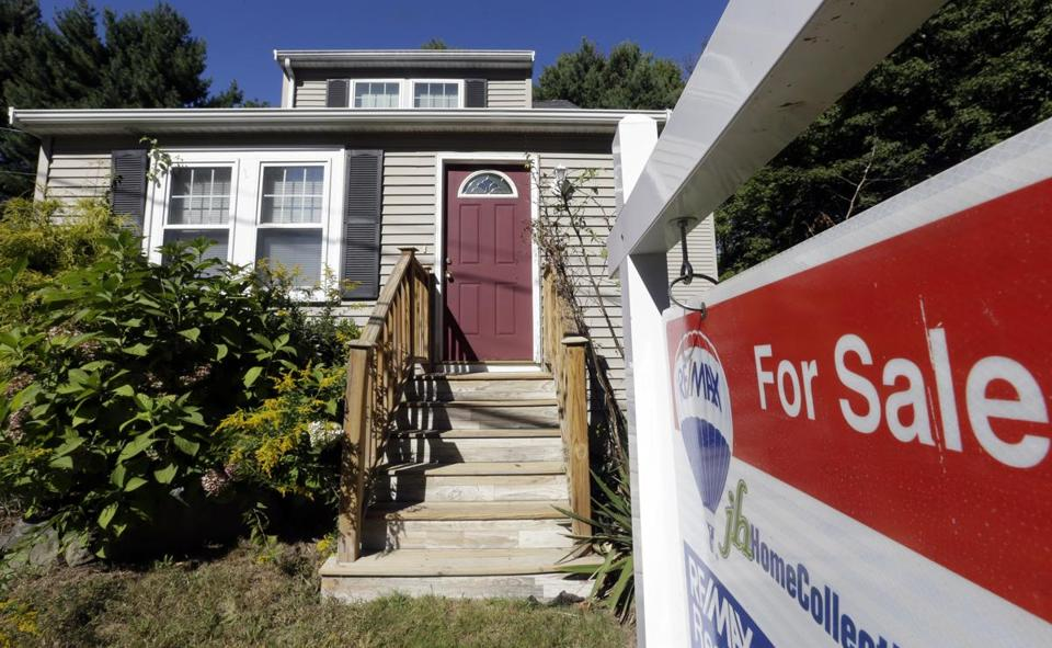 A home up for sale in Walpole in September. Mortgage rates have risen to 4.22 percent.