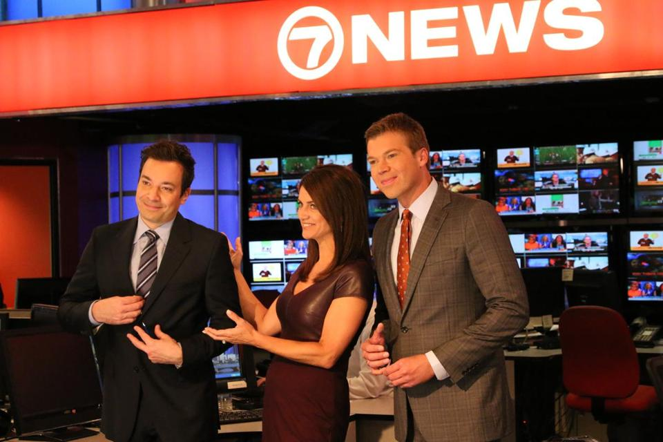 Jimmy Fallon (left) with anchors Kim Khazei and Adam Williams at the  WHDH-TV studio to tape promos.