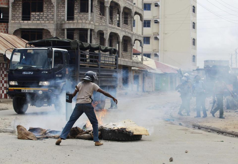 Policemen clashed with youths following a protest against the killing of a Muslim cleric in Mombasa. Sheik Ibrahim Ismail's followers blamed his death on security forces.