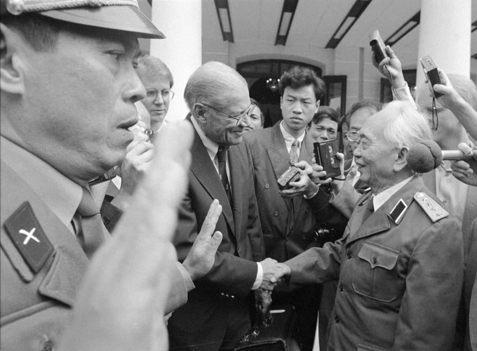 Former Defense secretary Robert McNamara greeted General Giap in Hanoi in 1995. Below, a 1950 photo with Ho Chi Minh (right), who became president of North Vietnam.