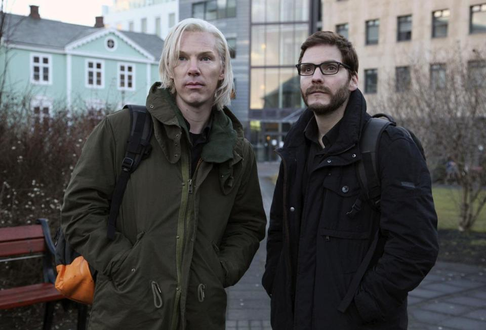 Benedict Cumberbatch (left) plays WikiLeaks' Julian Assange, above left with Daniel Bruhl as his partner.