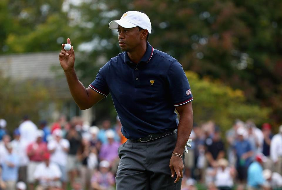 Tiger Woods celebrated making a putt on the fifth hole at Muirfield Village.