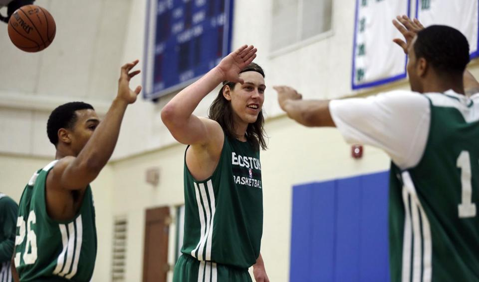 Kelly Olynyk (center) celebrated winning a drill with Phil Pressley (left) and Courtney Lee.
