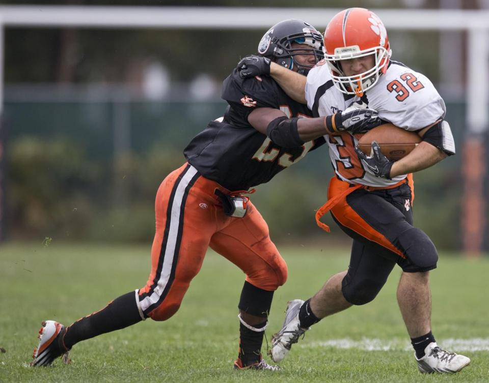 Stoughton's Malachi Baugh tackled Oliver Ames running back Matt Berksza during the first quarter.