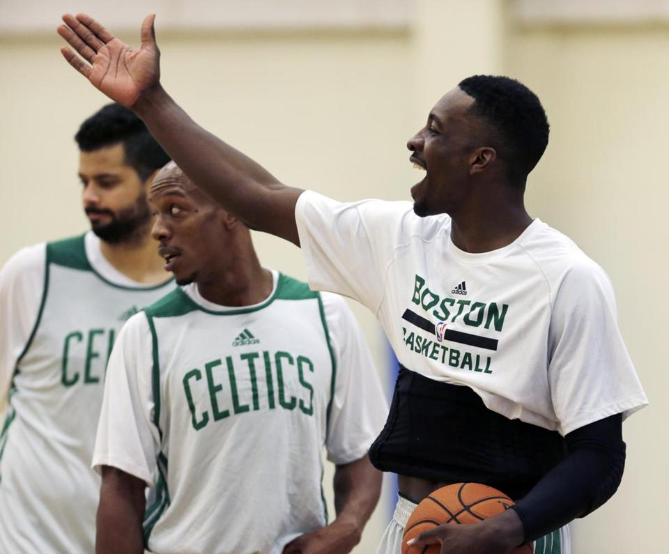 Jeff Green (right) took time out to joke around with teammates on the last day of a grueling training camp.