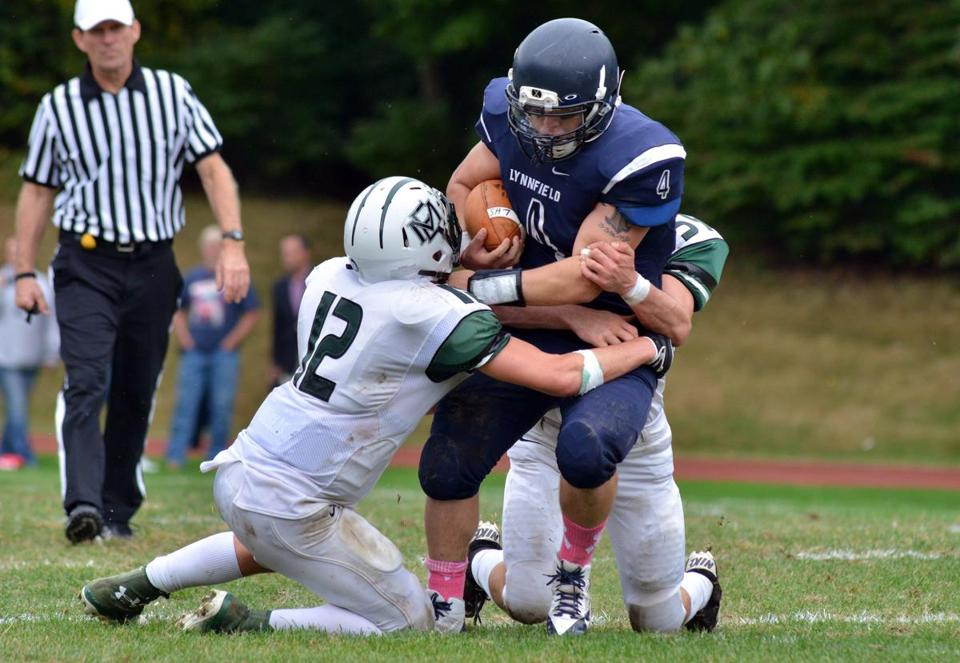 Kyle McGah is tackled by Chris Reynolds, but the Pioneer set a record for rushing TDs.