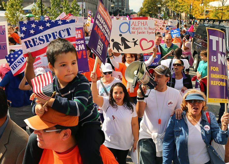 Mateo Cisterna, 3, of Dorchester sat atop his dad, Andres, as they marched with hundreds of others down Boylston Street to the Boston Common.