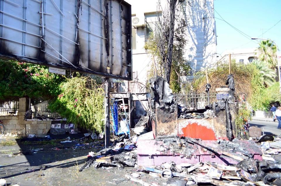 A photograph made available by Syria's Arab News Agency showed damage in al-Qasaa neighborhood in Damascus.