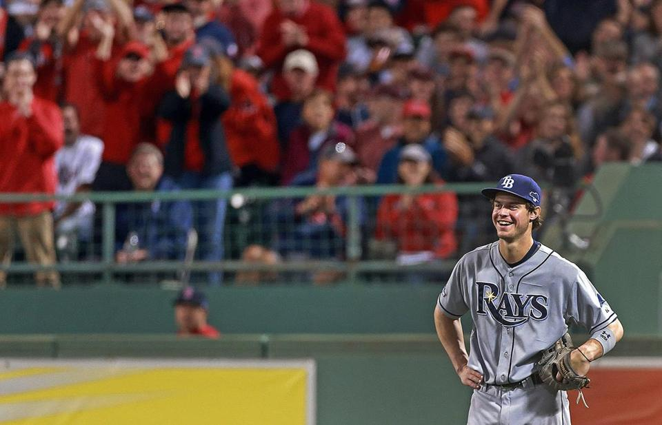 Rays right fielder Wil Myers breaks into a grin as the Red Sox fans give him a mock cheer after making a routine catch on a fly ball in the fifth inning.