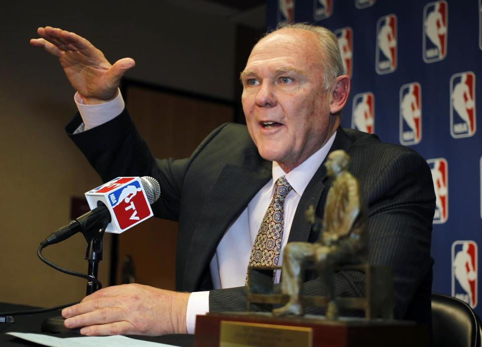 Nuggets coach George Karl sat next to the Coach of the Year trophy during a news conference in May.
