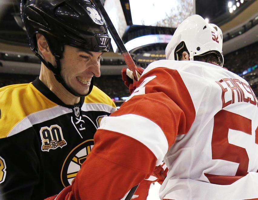Bruins captain Zdeno Chara has his game face on as he battles Detroit's Jonathan Ericsson against the glass.