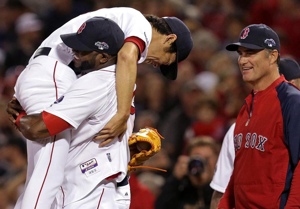 Koji Uehara gets a lift from David Ortiz after the Red Sox closer finished off Tampa Bay with just 11 pitches.
