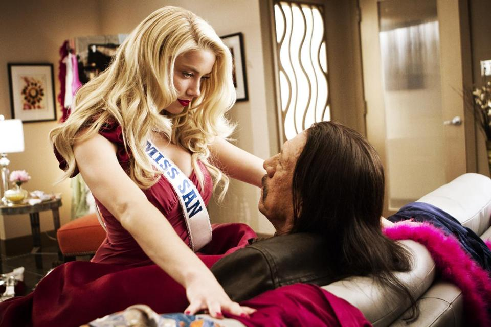 "Amber Heard is the government handler, posing as a beauty pageant contestant, of Danny Trejo, tasked in ""Machete Kills"" to take down a revolutionary armed with a nuclear missile."