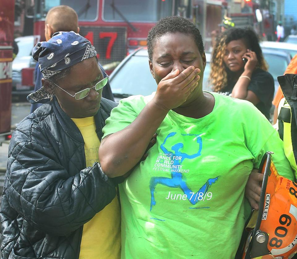 A resident was overcome with emotion after a fire broke out in her Dorchester house.