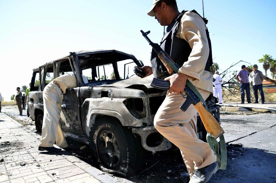 Soldiers inspected a burned-out car at the site of a suicide bomb attack at police offices in el-Tor, in southern Sinai, Egypt.