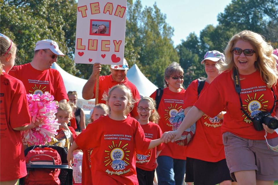 The author's granddaughter, Lucy, joins in the 2011 Buddy Walk for Down syndrome. This year's event is today.